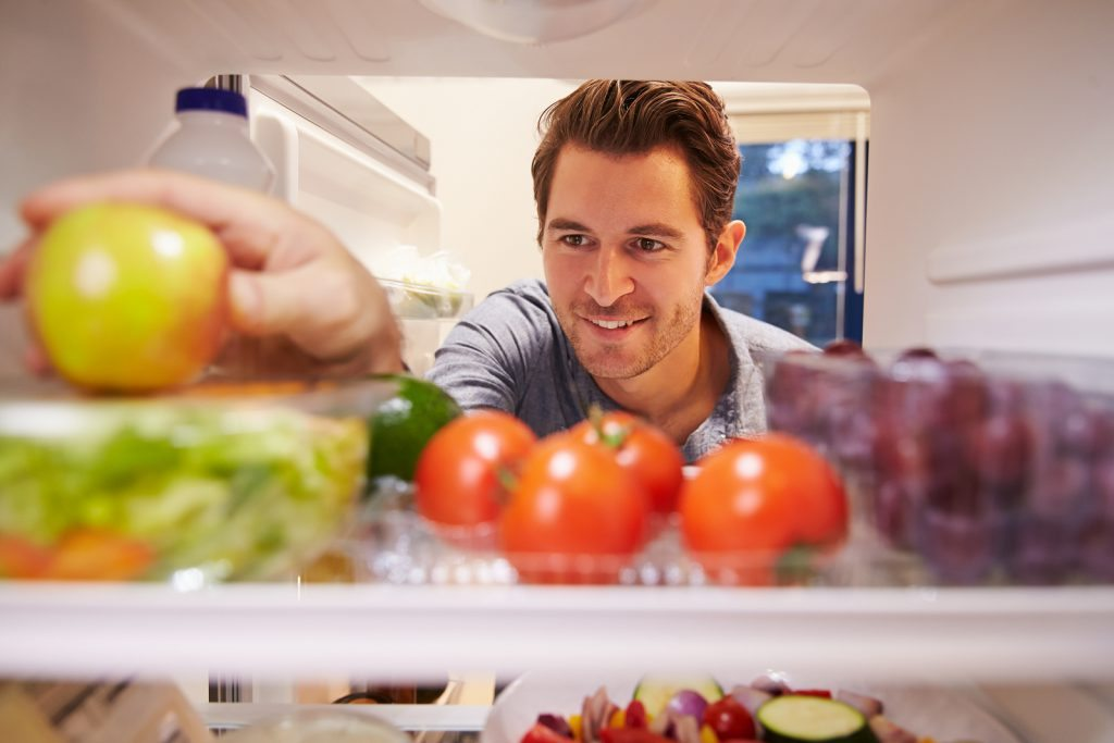 bigstock Man Looking Inside Fridge Full 77371499 1024x683 - What is the Relationship Between Cannabis and Obesity?